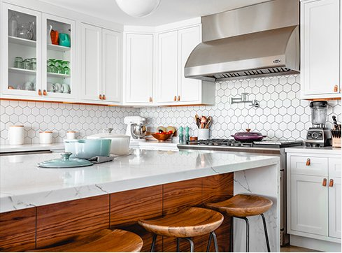 white and brown kitchen island with octagon backsplash and white cabinets