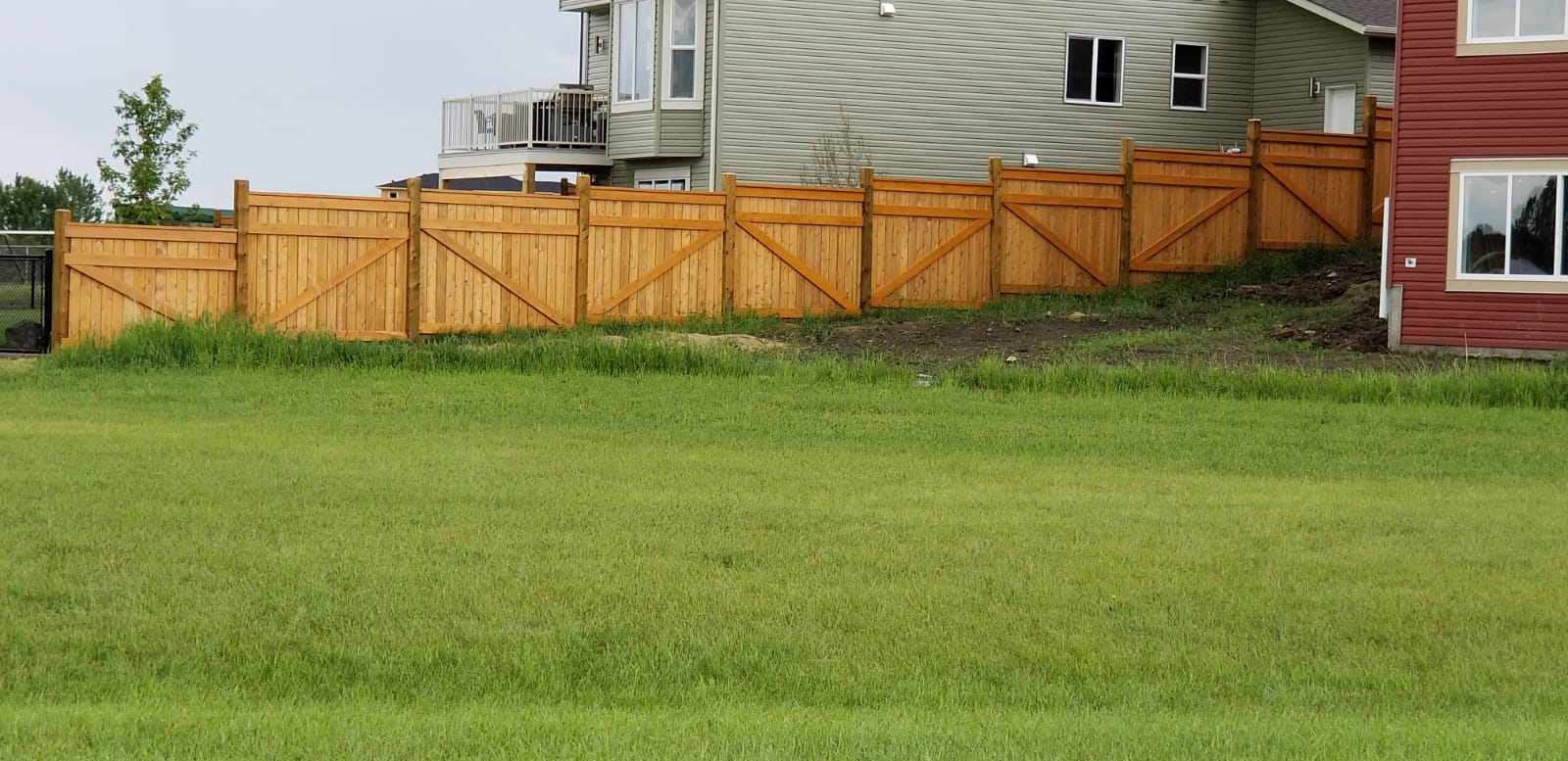 house fence wooden in red deer