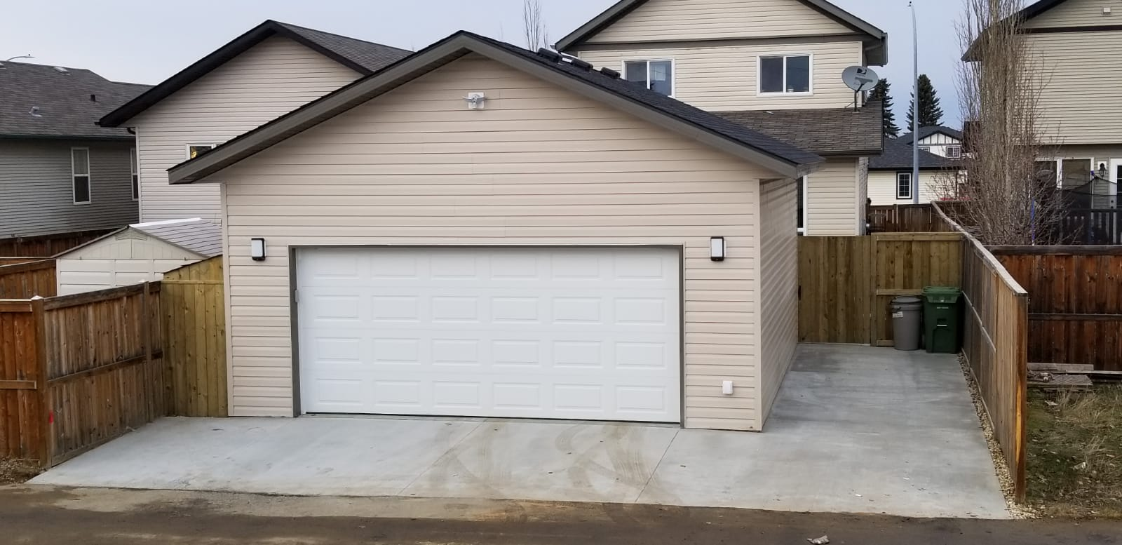 beige house and paved driveway in red deer
