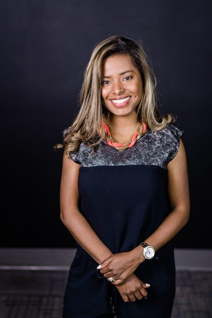 smiling woman in dark dress
